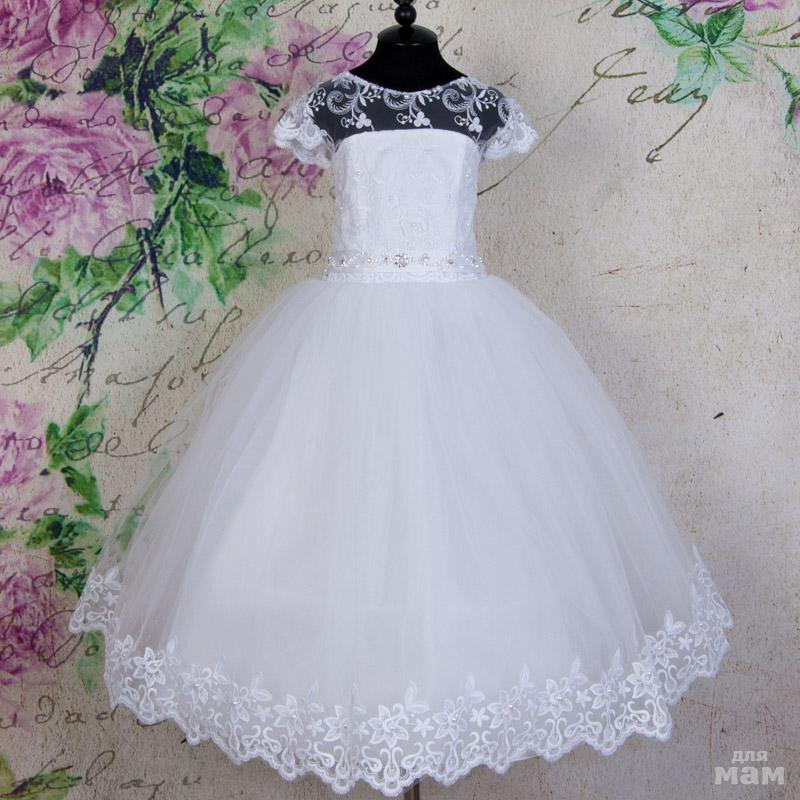 9da84bb8ca52373 Нарядное платье для девочки Евгения выполнено в белоснежном цвете. Юбка из  многослойного фатина украшена по низу шикарным кружевом, которое гармонично  ...